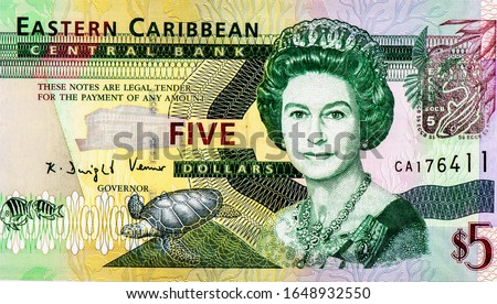 Queen elizabeth II, Portrait from Eastern Caribbean 5 Dollars 2003 Banknotes. An Old paper banknote, vintage retro. Famous ancient Banknotes. Collection.