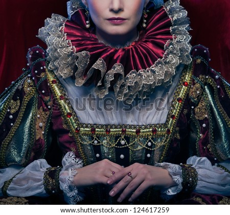 Queen in royal dress and luxuriant collar #124617259