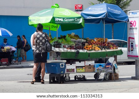 QUEENS, NEW YORK CITY - AUG. 28:  NYC Green Cart on street in Jamaica Queens, NYC seen on August 28, 2012.  Green Carts sell only fresh fruits and vegetables to promote healthy eating citywide.