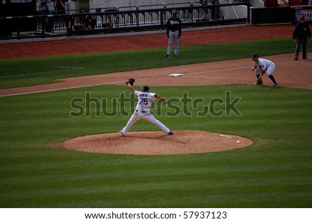 QUEENS, NY - APRIL 29: Mets closer Francisco Rodriguez pitches in a game against the Florida Marlins at Citi Field as third Baseman David Wright gets set April 29, 2009 in Queens, NY