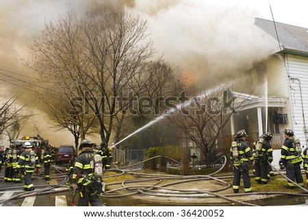 QUEENS,  NY - FEBRUARY 12: Firemen on duty fight fire on February 12, 2009 in Queens, New York.