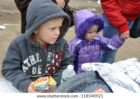 QUEENS, NY - NOVEMBER 11: Hungry kids getting help with hot food and supplies in the Rockaway beach area due to impact from Hurricane Sandy in Queens, New York, U.S., on November 11, 2012.