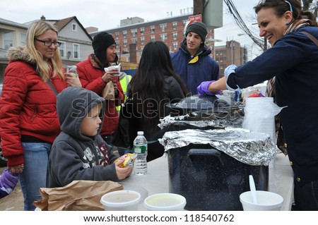 QUEENS, NY - NOVEMBER 11: People getting help with hot food, clothes and supplies in the Rockaway beach area due to impact from Hurricane Sandy in Queens, New York, U.S., on November 11, 2012.