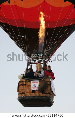 QUEENSBURY - SEPT 26: A Hot air Balloon takes flight with passengers on board at the 2009 Adirondack Balloon Festival, September 26, 2009 in Queensbury, NY