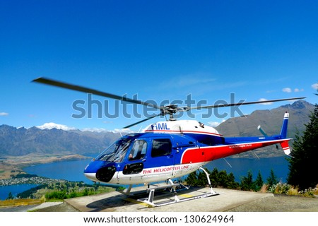 QUEENSTOWN, NEW ZEALAND - JANUARY 26: Helicopter on top of  Bob's Peak with the view on Lake Wakatipu in Queenstown, New Zealand on January 26, 2009. Queenstown is the 'Adventure Capital of the World'