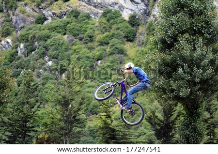 QUEENSTOWN, NZ - JAN 15:Young man performing tricks and stunts with his BMX Bike on Jan 15 2014.BMX riding became official Olympic sport in the 2008 Summer Olympic Games in Beijing, China.