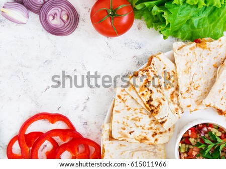 Quesadilla with chicken and corn on white background. Top view #615011966