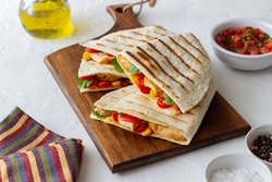 Quesadilla with chicken, tomatoes, corn, cheese and chilli. Mexican food Fast food
