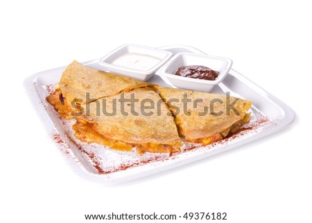 Quesadillas on whte plate with sauces