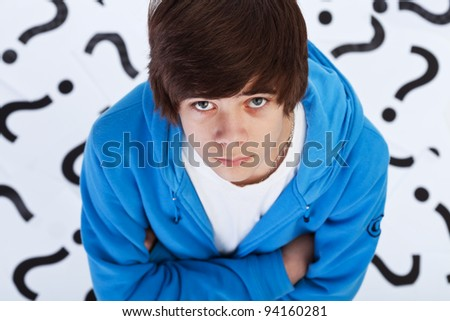 Quest of life - teenager boy wondering over question marks background
