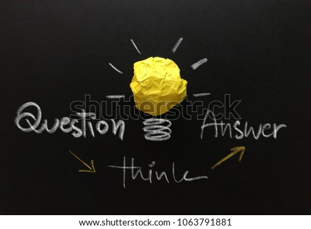 Question , answer and think process , concept of idea and innovation with yellow paper ball as light bulb, inspiration