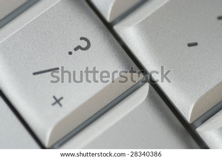 Question button from a Mac keyboard