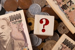 Question mark and japanese money