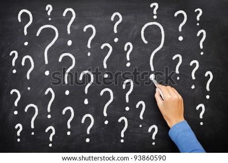 Question mark blackboard sign. Question marks on chalkboard. Decision, confusion, FAQ or other concept. Hand writing with chalk on school black board.