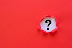 Question mark concept. Torn red paper with question mark on white background.