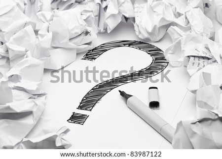 Question mark in the middle if crumpled papers - lack of inspiration concept