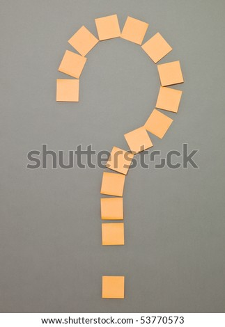 Question Mark made of Orange Adhesive Notes on grey background