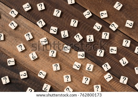 Question mark on alphabet tiles. question mark on wooden table background #762800173
