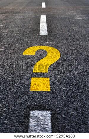 Question mark on asphalt road. Travel to unknown destination concept.