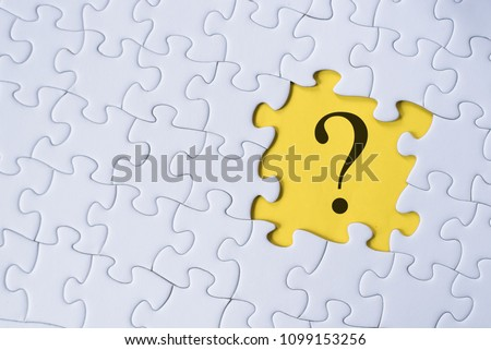question mark on jigsaw puzzle with yellow background. question, faq and q&a concept Сток-фото ©