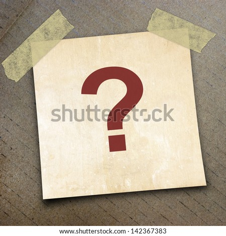 question mark on short note paper on the packing paper box texture background