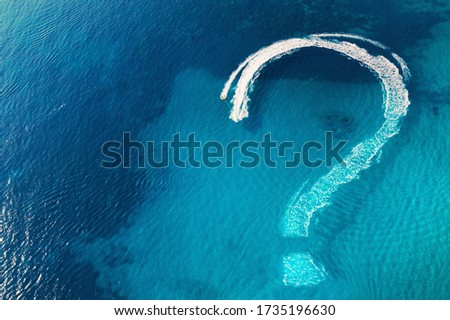 Question mark on tropical sea water surface as symbol of uncertainties end of global quarantine due coronavirus covid-19 and closed countries borders, impossible travel concept.