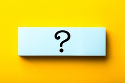 Question Mark paper is isolated on the yellow background.