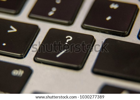 Question mark  slash symbol Keyboard key button press type close up macro desktop laptop computer black silver detail technology blog write letter alphabet