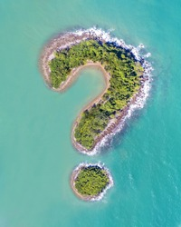 Question Mark Symbol Green Island Drone Aerial Montage with Boat in Turquoise Ocean Sea Symbolic Image with Copy Space No Buildings Isolated