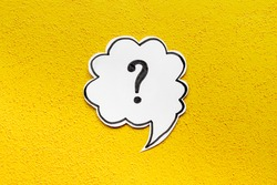 Question mark symbol on speech bubble, top view