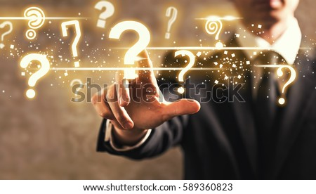 Question Marks with businessman on dark vintage background