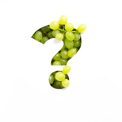 Question punctuation mark made of green grape and cut paper isolated on white. Appetizing typeface of fresh berries