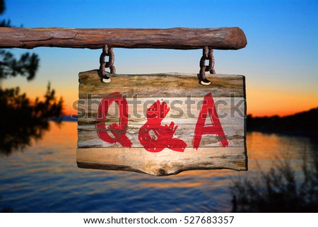 Questions and answers motivational phrase sign on old wood with blurred background