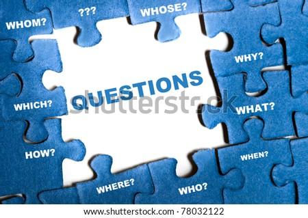 Questions blue puzzle pieces assembled - stock photo