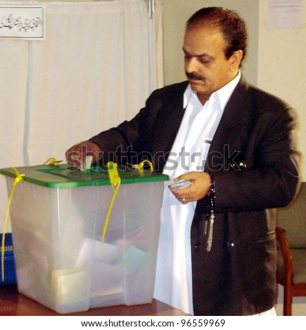 QUETTA, PAKISTAN - MAR 02: A member of provincial assembly casts his vote during Senate Elections held at Balochistan Assembly building on Friday, March 02, 2012  in Quetta.