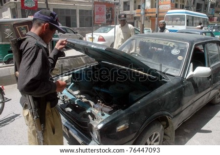 QUETTA, PAKISTAN - MAY 02: Policeman checks documents of vehicle during snap-checking as security has been tightened in city after the killing of Osama Bin Laden, on May 02, 2011 in Quetta, Pakistan.