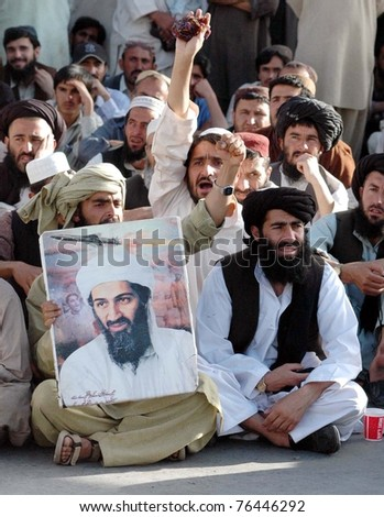 QUETTA PAKISTAN MAY 02 Supporters of Jamiat Ulema Islam-Nazaryati shout slogans against killing of Osama Bin Laden during protest rally on Monday May 02 2011 in Quetta Pakistan.