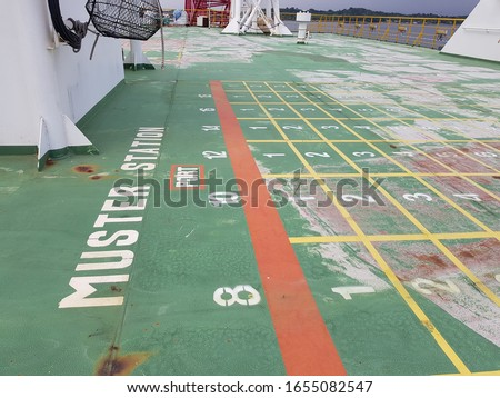 Queue lines at emergency muster station assembly on top deck of a construction work barge  Stock foto ©