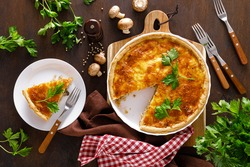 Quiche lorraine. Homemade savory pie, tart with chicken meat, fried mushrooms and cheese. French cuisine.