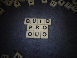 Quid pro quo (in Latin), word cube with background.