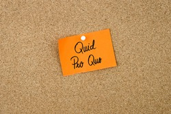 QUID PRO QUO written on orange paper note pinned on cork board with white thumbtacks, copy space available