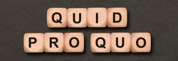 quid pro quo written on wooden cubes