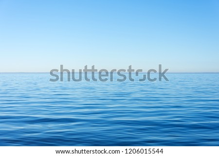 Quiet calm surface of water, sea and horizon and clear sky #1206015544