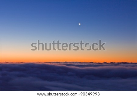 quiet evening scene moon on a dusk sky