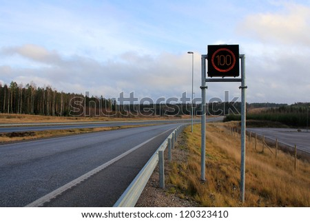 Quiet motorway with maximum speed sign.