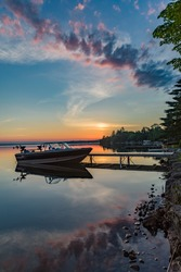 Quiet peaceful fishing boat at the dock at the cottage in Kawartha Lakes Ontario Canada on Balsam Lake