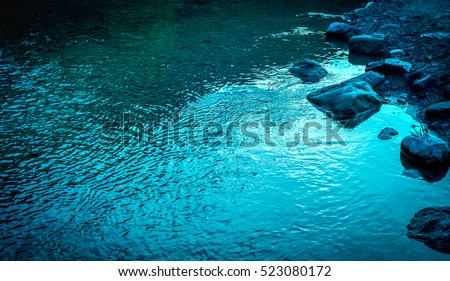 Quiet river water in the evening light. Texture background #523080172