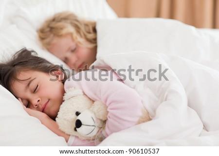Quiet siblings sleeping in a bedroom