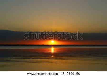 """quiet water of the Caribbean sea. dawn landscape and the first rays of the sun in the dawning sky. """"bay of pigs"""". Playa Larga. Cuba #1342190156"""