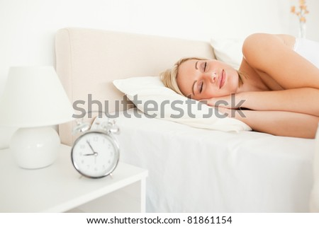 Quiet woman sleeping in her bedroom